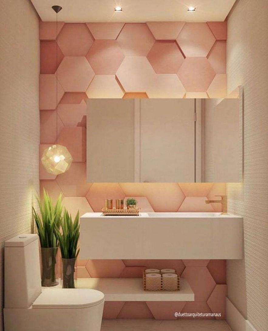 bathroom, pink hexagonal wall pink, white wall, white toilet, white floating sink, mirror, pendant