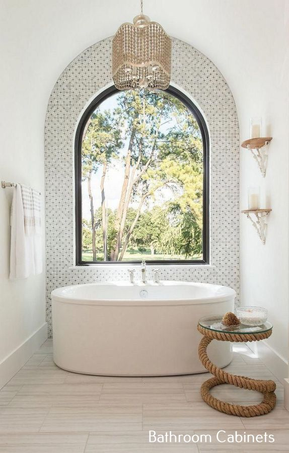 bathroom, vaulted ceiling, chandelier, white accent while, white marble floor, white round tub, side table