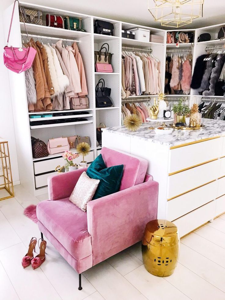 beauty room, white wooden floor, white cabinet, white marble counter top, white shelves, golden pendant, pink chair
