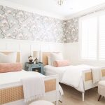 Bedroom, Brown Floor, White Wainscoting, Grey Patterned Wall, White Rattan Bed Platform, White Framed Window, White Ottoman