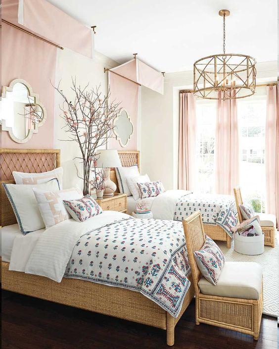 bedroom, dark wooden floor, rattan bed platform, rattan chairs, pink curtain, golden pendant, pink curtain