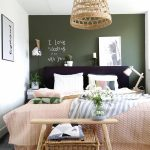 Bedroom, Grey Rug, Green Accent Wall, Black Headboard, Small Side Table, Rattan Pendant, White Wall, Pink Blanket, Wooden Bench