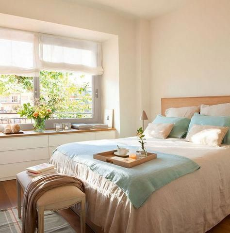 bedroom, white cabinet in the window sill, wooden top, white wall, wooden bed platform, white bench