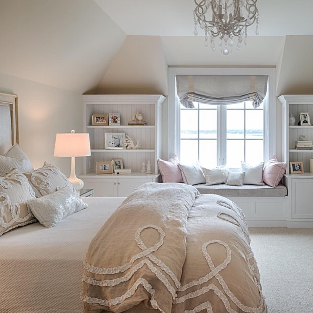 bedroom, white rug, white cabinet, white shelves, chandelier, brown bedding, white table lamp