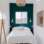 Bedroom, White Wall, Wooden Floor, Dark Green Accent Wall, Sconces, Rattan Pendant