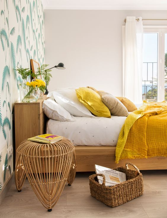 bedroom, wooden floor, accent wall, white wall, wooden bed platform, rattan side table, rattan basket, white curtain