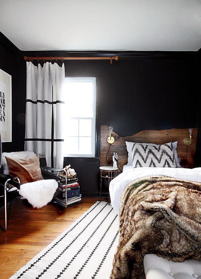bedroom, wooden floor, black wall, black chair, wooden headboard, small side tabl