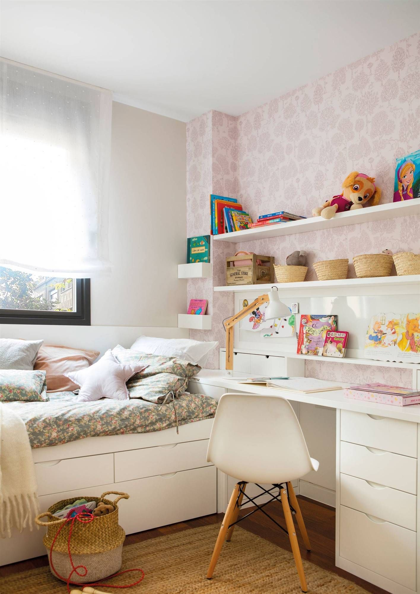 bedroom, wooden floor, white built in table, white bed platform, pink wallpaper, white shelves, rattan rug, white modern chair