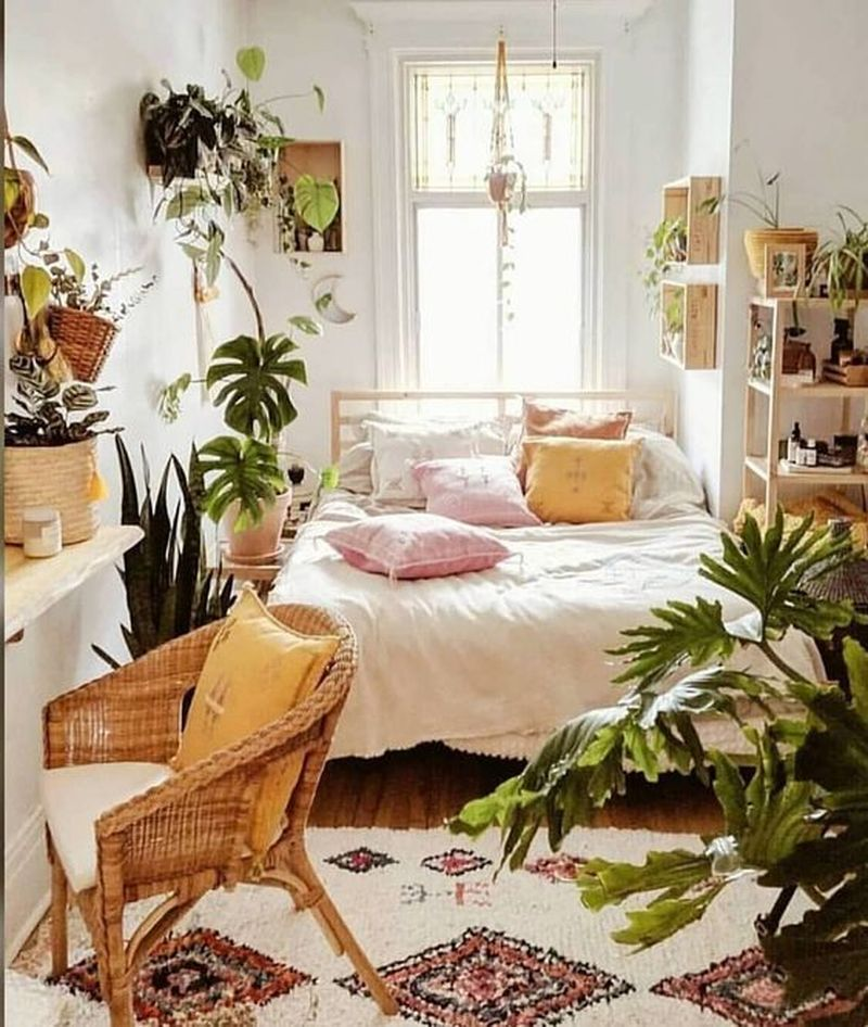 bedroom, wooden floor, wooden bed platform, white bedding, plants accessories, floating wooden shelves, floating woode table, rattan chair