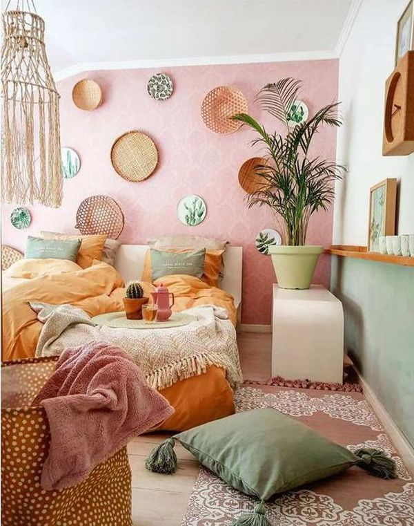 bedrooom, wooden floor, pink accent wall, blue wall, floor bed, white table,