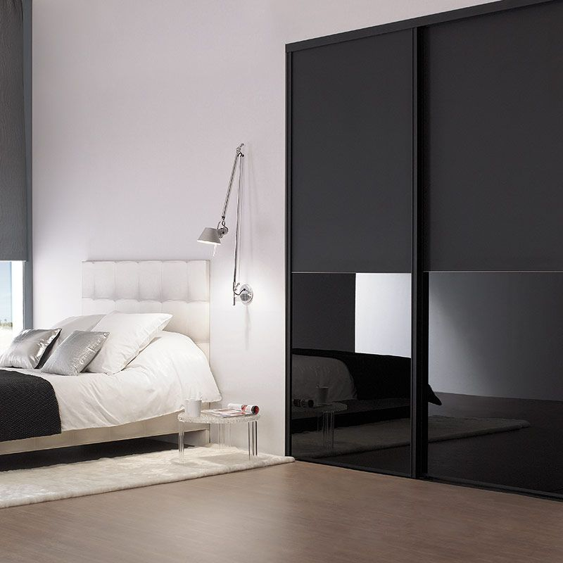 black cupboard, glossy bottom look, wooden floor, white rug, white wall, white headboard, white sconce