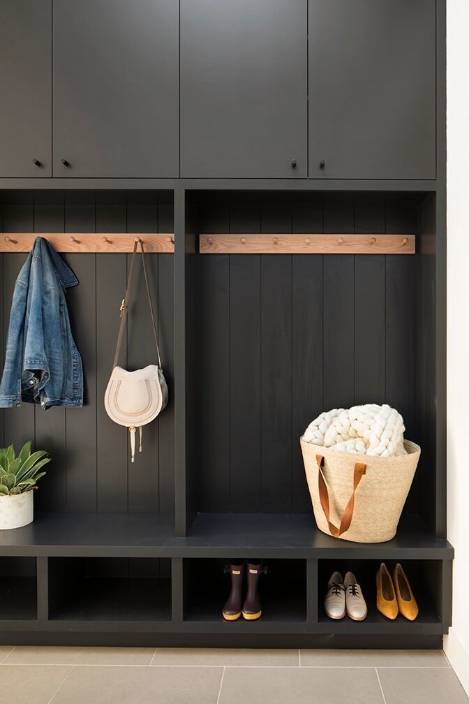 black entrance, black cabinet, black shelves, grey floor