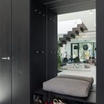 Black Entrance, Black Cupboard, Black Shelves, Grey Cushion, Mirror