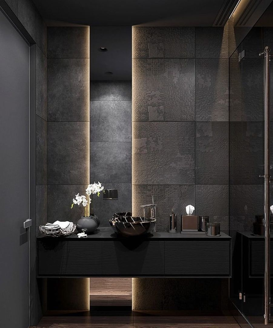 black vanity, black marble wall, black floating cabinet, black round sink, LED lamp