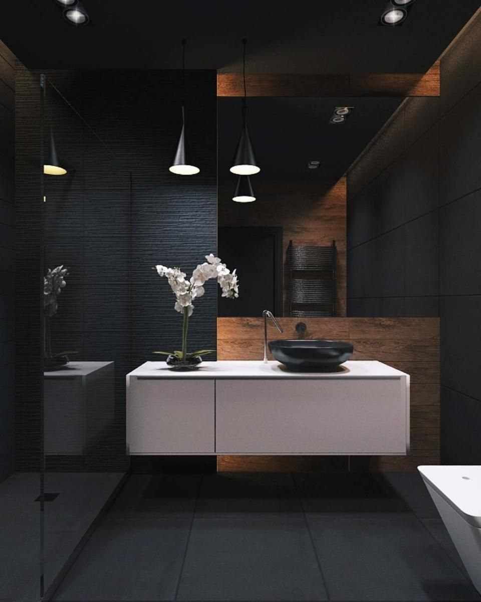 black vanity, wooden accent, white floating cabinet, black floor, black pendant, white tub