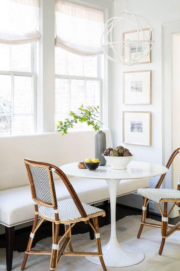 breakfast nook, black floor, black white bench, white round tulip, rattan chairs, white wall