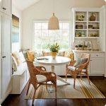 Breakfast Nook, Wooden Floor, White Wall, Rug, White Bench, White Round Table, Rattan Pendant, White Floating Shelves, White Cabinet