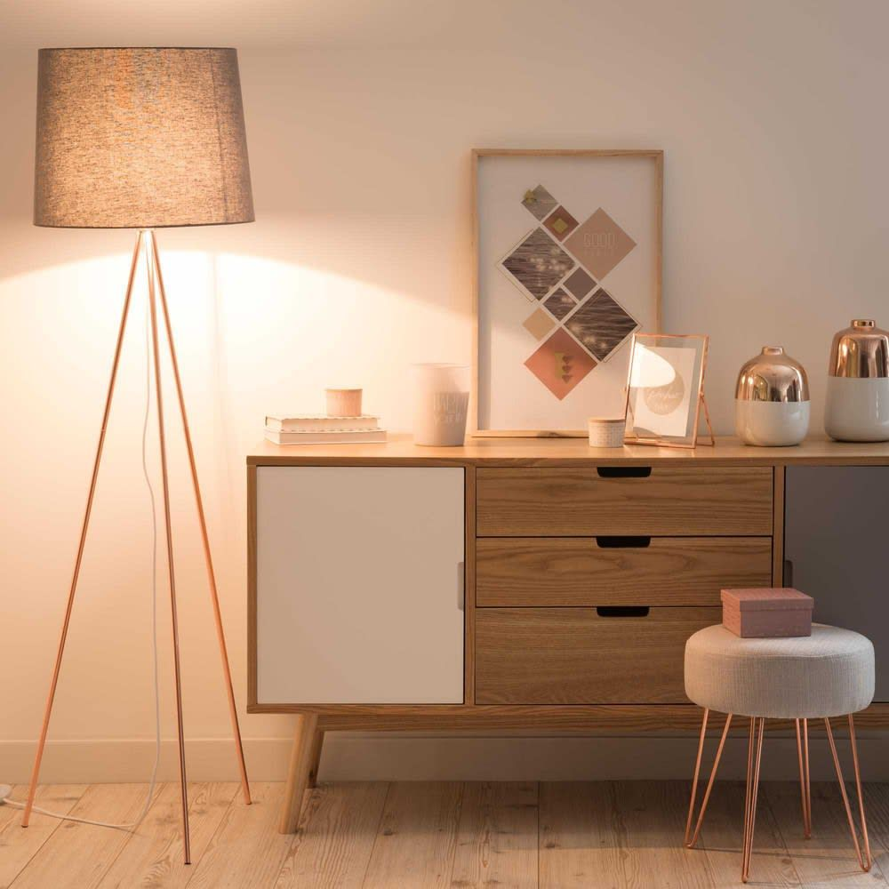 brown floor lamp with trpod legs