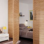 Brown Rattan Partition, Grey Floor, White Wall, White Side Table, Grey Bedding