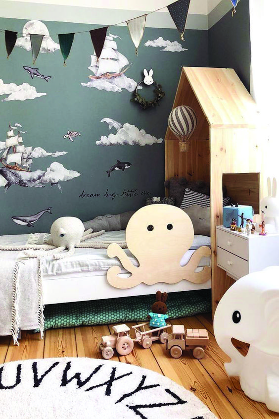 child bedroom, wooden floor, white wooden bed, white side table, sea wall paper, wooden headboard with octopus shape