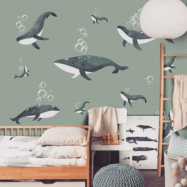 child bedroom, wooden floor, wooden bed platform, wooden rack, round woven ottoman, wallpaper with whales
