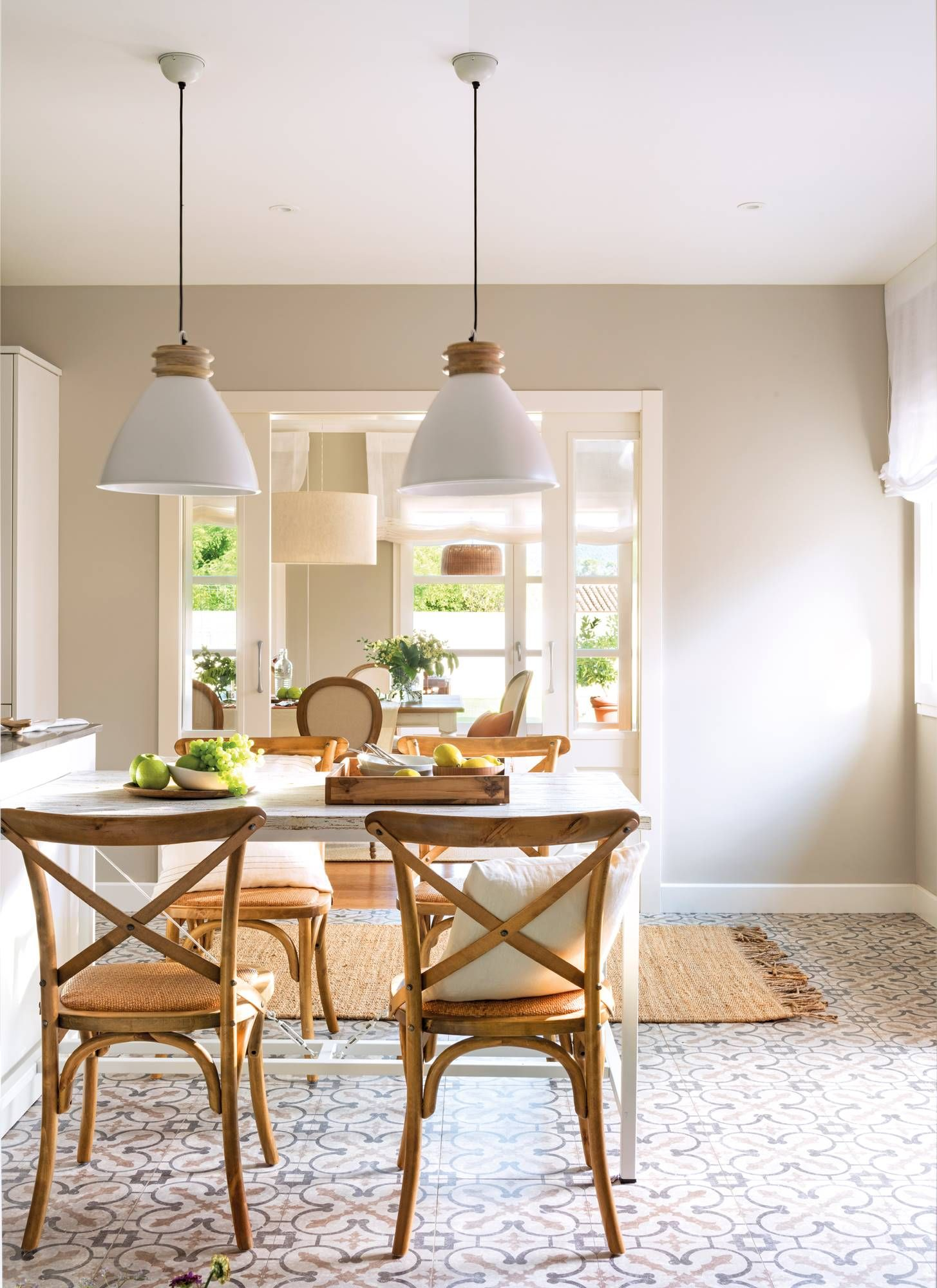 dining room, patterned floor, white wooden table, wooden chairs, white pendants, rattan tug