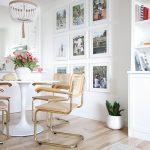 Dining Room, Wooden Floor, White Wall, White Round Tulip Table, Wooden Table With Golden Support, White Pearl Chandelier, White Shelves