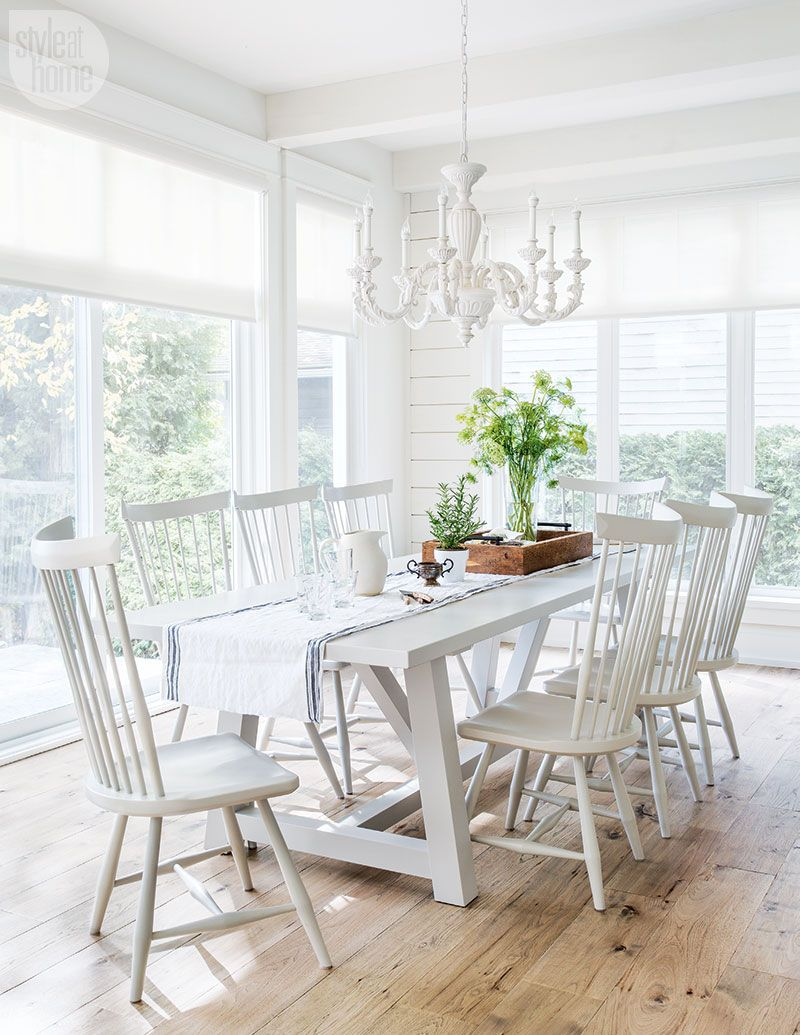 dining room, wooden floor, white wooden wall, white wooden dining set, white chandelier