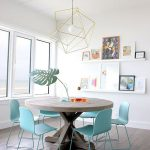 Dining Room, Wooden Floor, Wooden Round Table, White Wall, White Floating Shelves, Golden Lines Pendant, Blue Chairs