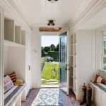 Entryway, Brick Floor, White Wooden Shelves, Blue Door, White Wooden Bench, Striped Cushion, Window Bay