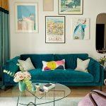 Green Velvet Sofa, Wooden Floor, Grey Rug, Purple Velvet Chair, Glass Coffee Table, Paintings, White Wall