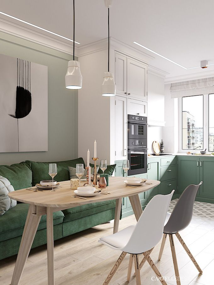 kitchen, green bottom cabinet, white cabinet, soft green wall, white wall, green sofa, wooden table, white modern chairs, white pendants
