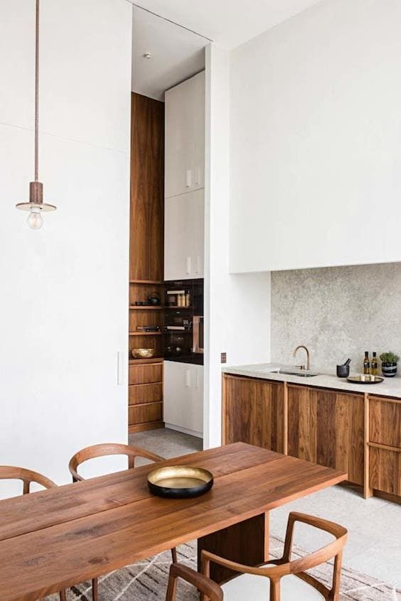 kitchen, grey floor, wooden table, wooden chairs, white wall, wooden cabinet, grey counter top