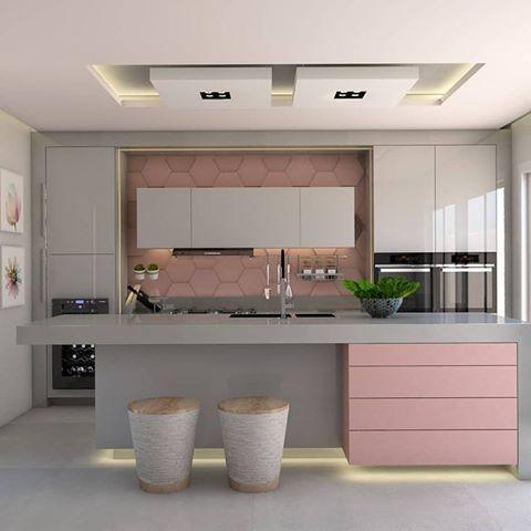 kitchen, white floor, pink hexagon backsplash, white cabinet, gren island with pink accent