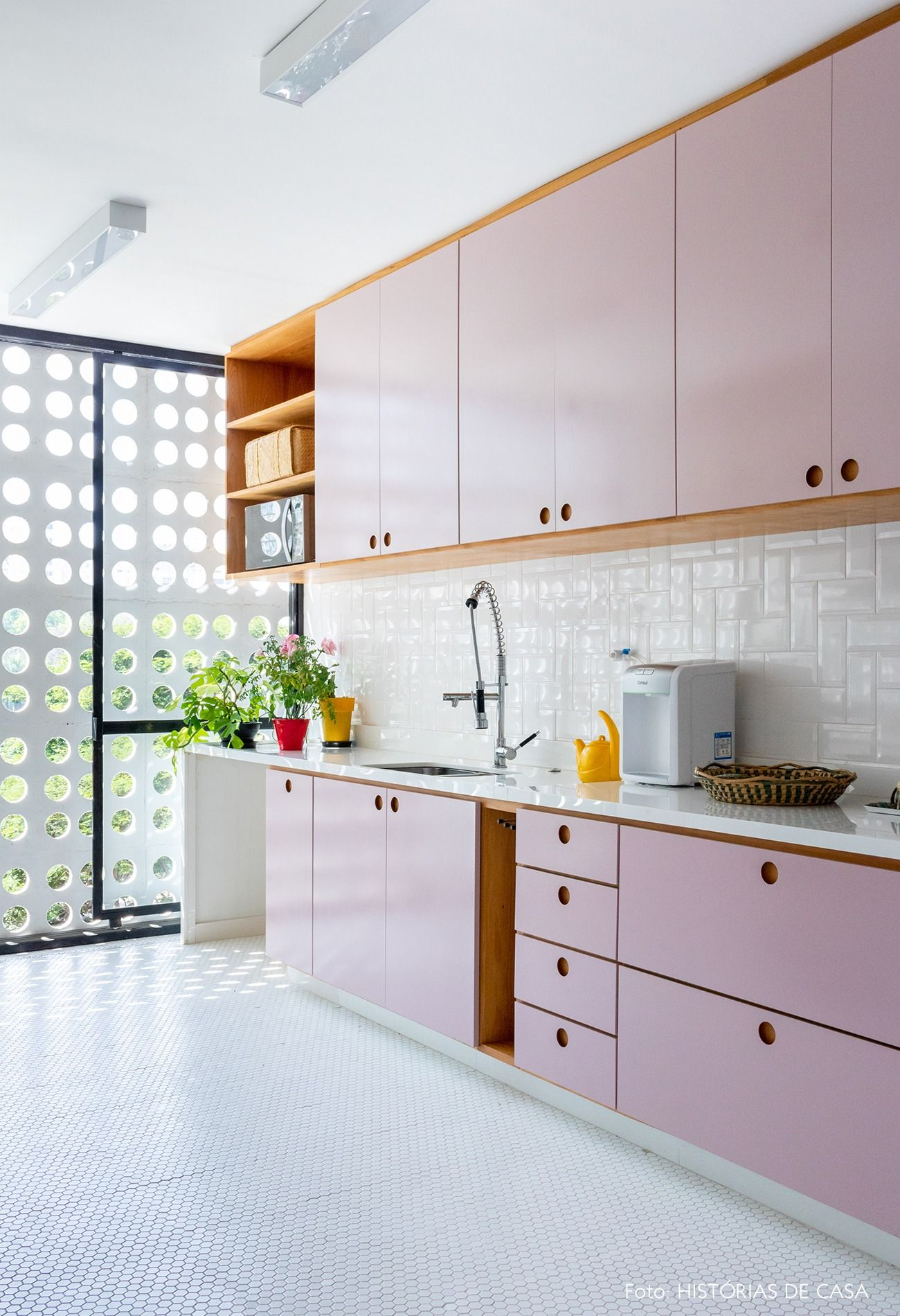 kitchen, white floor tiles, white backsplash, pink top cabinet, pink bottom cabinet, wooden shelves, white counter top