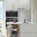 Kitchen, White Floor, White Cabinet Island, White Wall, Wooden Grid, Black Stool, White Pendant