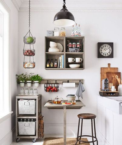 kitchen, white floor, white cabinet, white apron sink, floating shelves, black pendant, wooden floating table, wooden stool