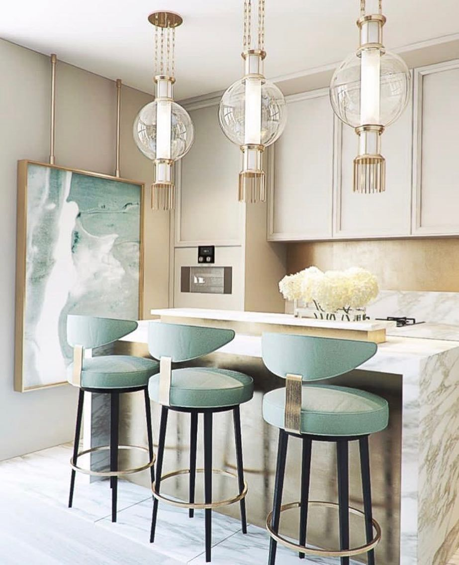 kitchen, white marble floor, cream marble island and backsplash, cream top cabinet, round pendants, cream wall