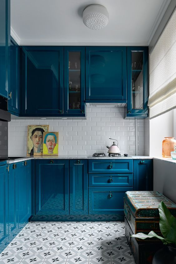 kitchen, white subway bcksplash, patterned floor, blue kitchen cabinet, blue chest,