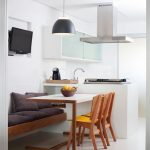 Kitchen, White Wall, White Floating Top Cabinet, White Table, Wooden Floating Bench, Black Pendant, Wooden Chairs