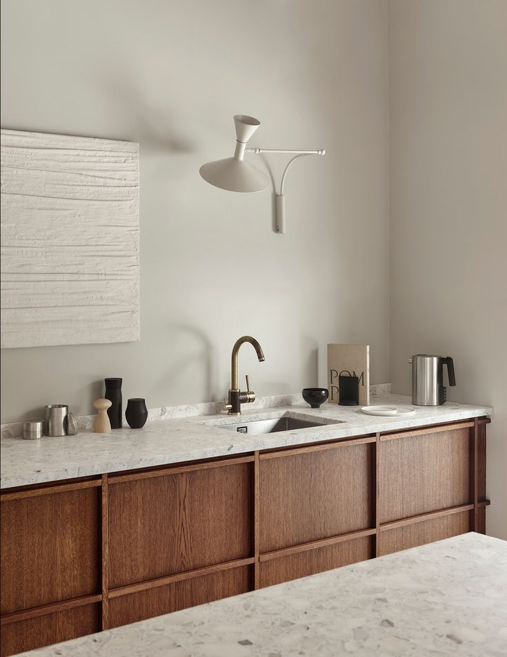 kitchen, white wall, wooden cabinet, white marble top, white sconce