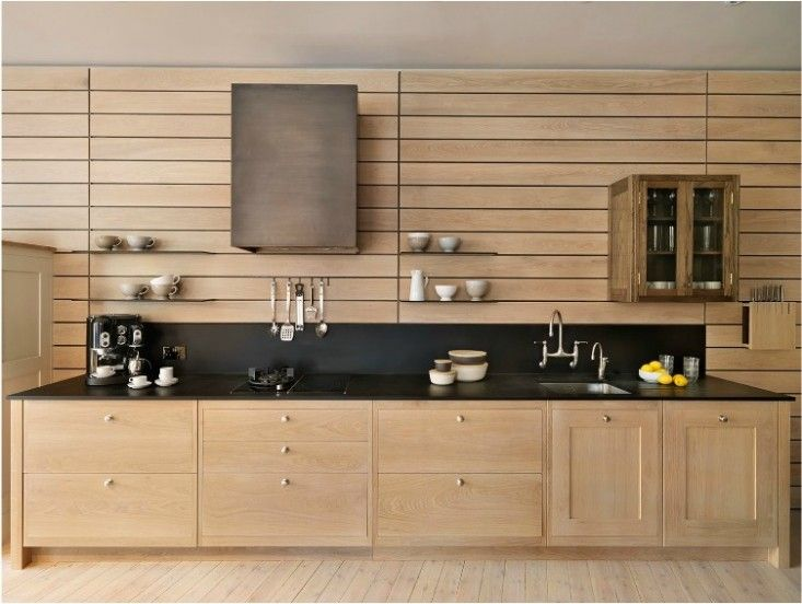 kitchen, wooden cabinet, wooden wall, black counter top, low black backsplash, wooden floor