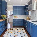 Kitchen, Wooden Floor, Blue Cabinet, White Hexagonal Backsplash, Hexagonal Patterned On The Rug, Silver Hood
