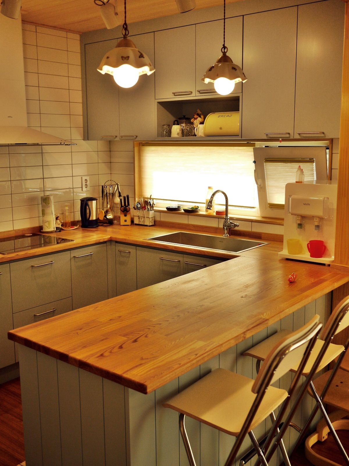 kitchen, wooden floor, green wooden cabinet, wooden counter top, grey cabnet, pendant