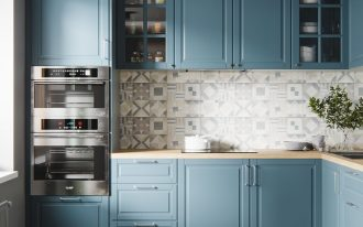 kitchen, wooden floor, patterned backsplash, blue cabinet, wooden counter top