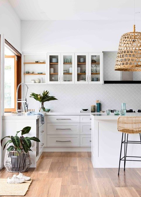 kitchen, wooden floor, white cabinet, white backsplash, white glass cabinet, rattan pendant, rattan stools