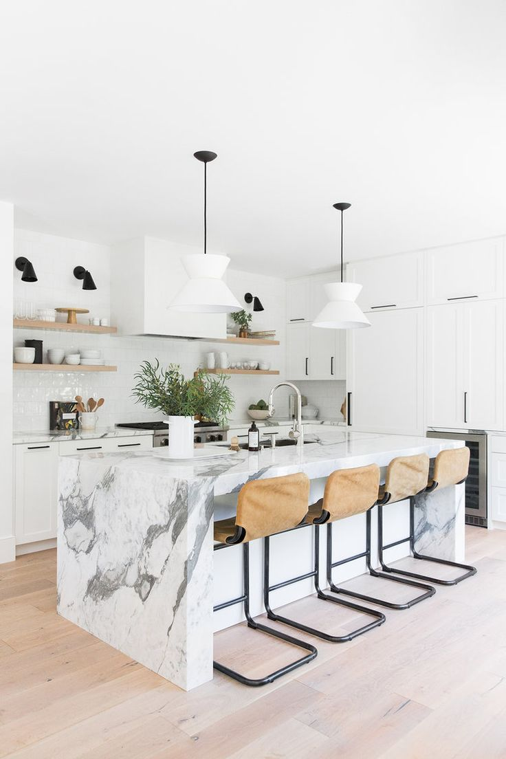 kitchen, wooden floor, white island, white backsplash, white cabinet, white pendants, brown stools