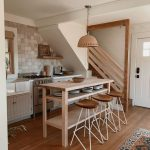 Kitchen, Wooden Floor, White Wooden Cabinet Under The Stairs, Wooden Table With Wooden Stools