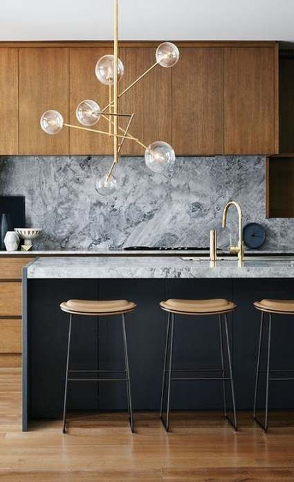 kitchen, wooden floor, wooden top cabinet, grey marble backsplash, grey marble counter top, black island, bulb chandelier