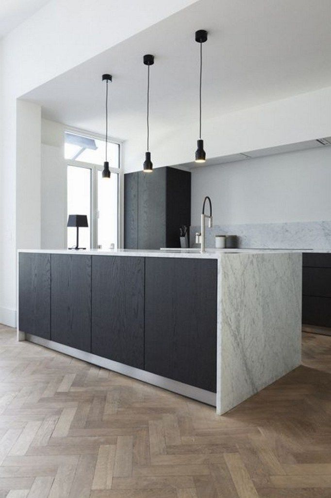kitchen, wooden herringbone floor, white wall, white marble counter top and backsplash, black cabinet, black pendants, black table lamp